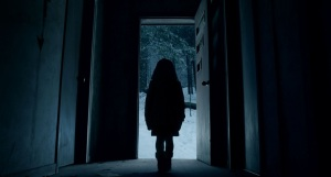 little-girl-in-dark-doorway