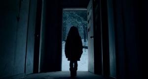 little-girl-in-dark-doorway